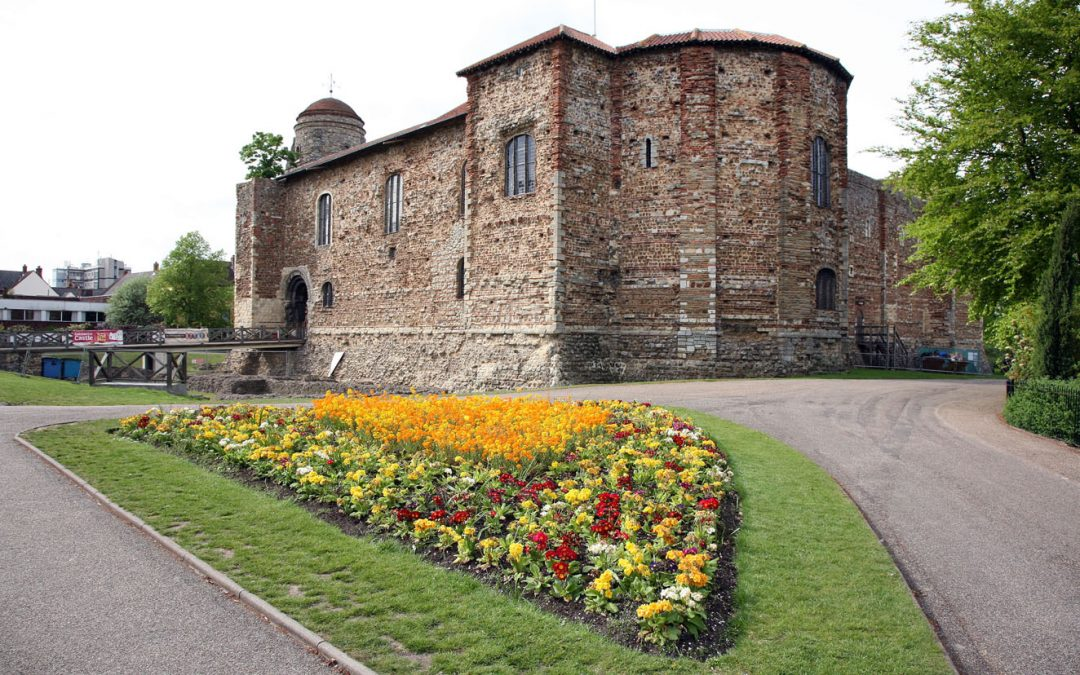 A view of Colchester Castle from the grounds including some flower arrangement
